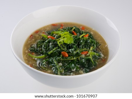 Vegetable soup on isolated white - stock photo