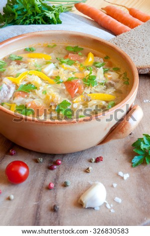 Vegetable soup on wooden board - stock photo