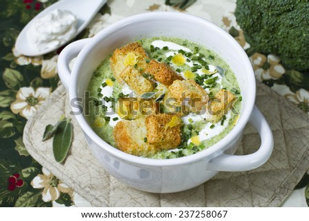 Vegetable soup with broccoli, kale, cream and croutons - stock photo