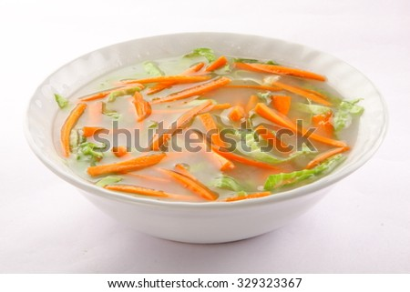Vegetable soup with cabbage ,carrots and herbs,Selective focus photograph. - stock photo