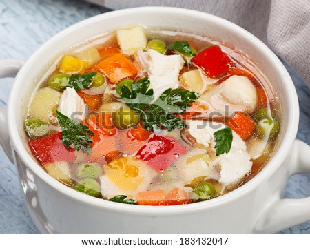 Vegetable soup with chicken on table - stock photo