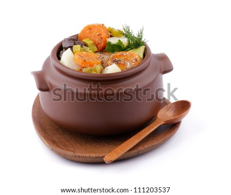 Vegetable Stew in Brown Pot on Wooden Plate with Spoon isolated on white background - stock photo