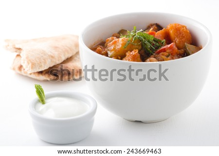 Vegetable tagine with yogurt and mint - stock photo