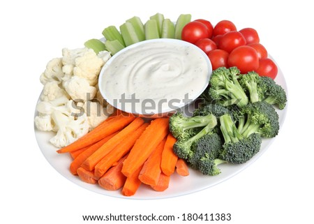 Vegetable tray with cauliflower, celery, tomatoes, broccoli, carrot sticks and ranch dip - stock photo