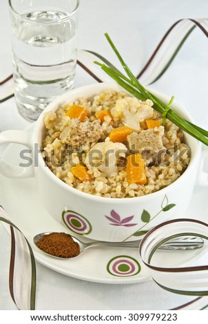 vegetables and cereals, cooked bulgur, seitan, carrot, cabbage, cauliflower, wheat, cereal, cous cous, semolina, boiled, stew, grain, vegetarian food, vegan, veggie - stock photo