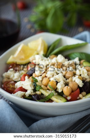 Vegetables and couscous salad with feta cheese and basil - stock photo