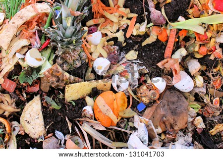 Vegetables and eggs on a compost shelter - stock photo