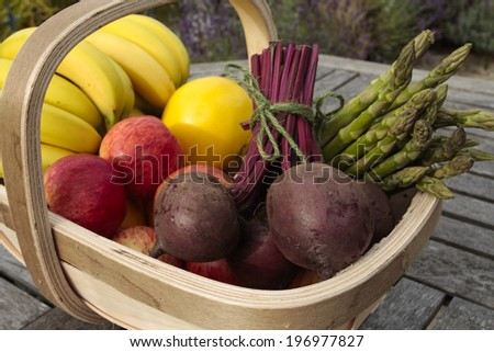 Vegetables and fruit mixed in basket - stock photo