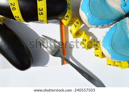vegetables and fruits for weight loss, a measuring tape, diet, weight loss, measuring tape, healthy eating, healthy lifestyle concept.Notepad,diary,eggplant,Apple,pear - stock photo