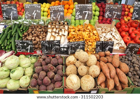 Vegetables and Fruits in Crates at Farmers Market - stock photo
