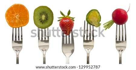 vegetables and fruits on the forks, diet concept - stock photo
