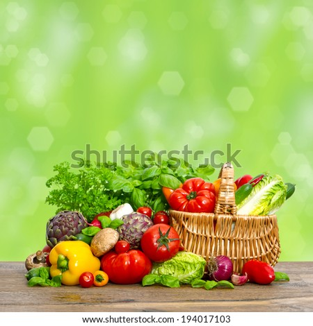 vegetables and herbs. fresh raw food ingredients. shopping basket - stock photo