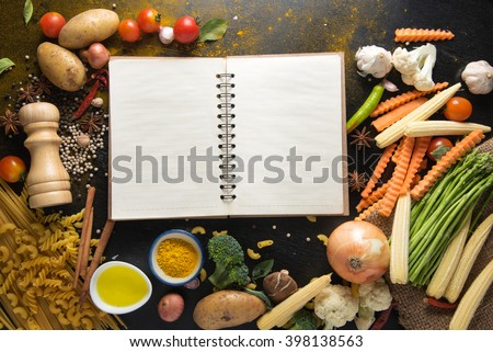vegetables and spices for tomato sauce,pasta tagliatelle with tomatoes on dark background, top view - stock photo
