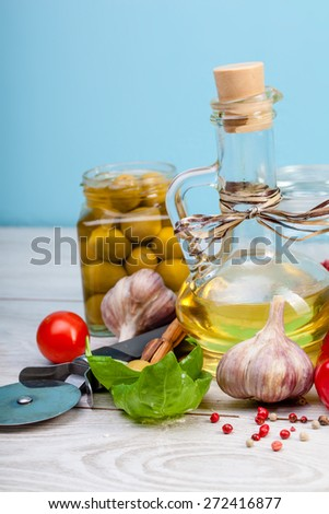 Vegetables and spieces on wooden table - stock photo