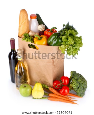 vegetables and wine in a paper bag isolated on white - stock photo