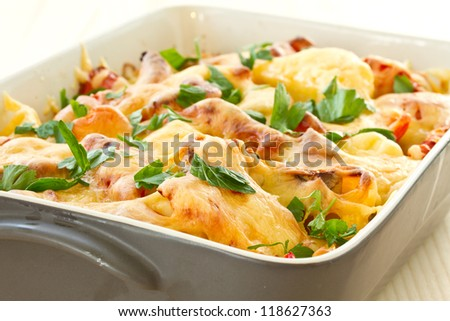 vegetables baked with cheese and sprinkle herbs - stock photo