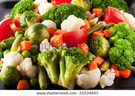 Vegetables: cauliflower, brussels sprouts, broccoli, carrots, string beans  and tomatoes - stock photo