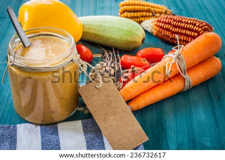 vegetables cream in glass bottle with label - stock photo