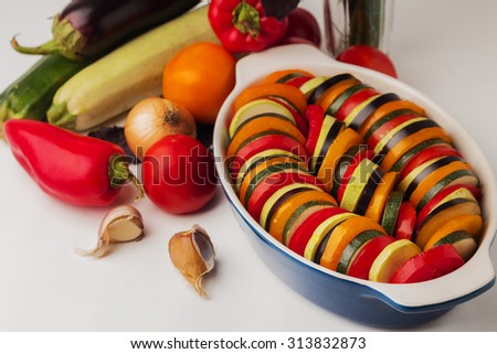 Vegetables for Ratatouille - eggplant, zucchini, tomatoes, peppers, garlic, onion. Selective focus. - stock photo