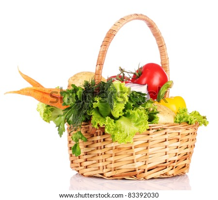 vegetables in a basket isolated on white - stock photo