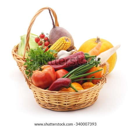 Vegetables in baskets isolated on white background. - stock photo