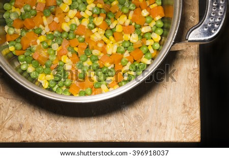 Vegetables in stock pot on wooden table, Food Conceptual Photo, top view - stock photo