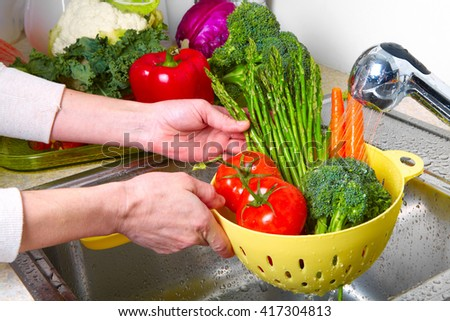 Vegetables  in the sink on kitchen. Fresh vegetables - stock photo