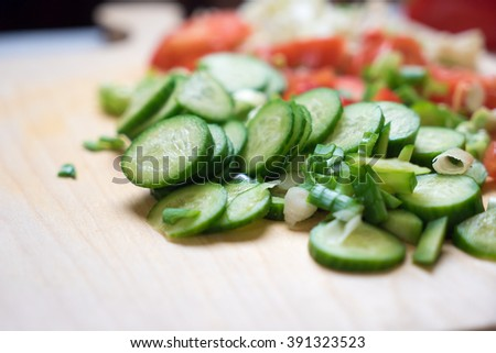 Vegetables on a cutting board. Domestic kitchen, closeup photography of  the cooking process. Raw food imagery. - stock photo