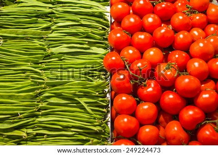 Vegetables on a market stall in Barcelona, La Boqueria, Barcelona Spain - stock photo
