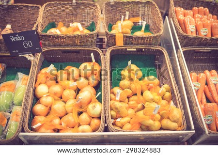 Vegetables on stall in a supermarket vintage color - stock photo
