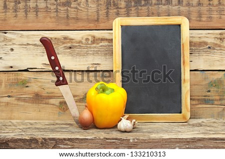 vegetables on the wooden background - stock photo