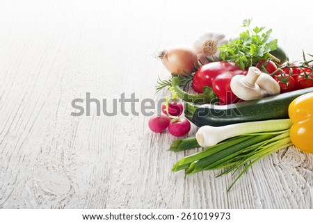 Vegetables on white wooden background close up  - stock photo