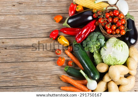 Vegetables on wood background with space for text, top view. Organic food. - stock photo