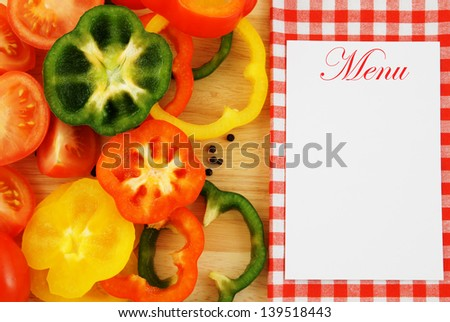 Vegetables on wooden background and tablecloth with blank card - stock photo