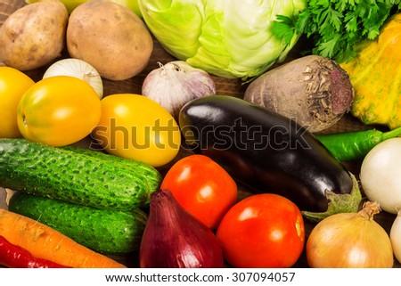 Vegetables on wooden desk - stock photo