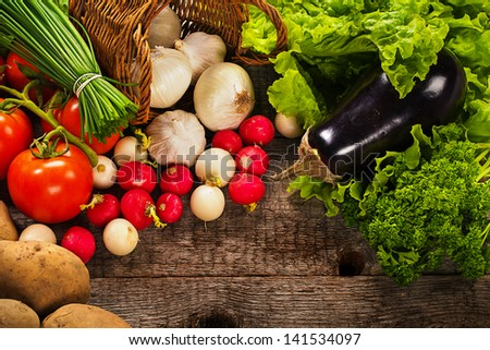 vegetables over wooden background - stock photo