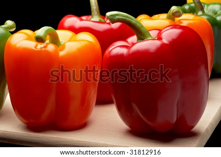 Vegetables - Peppers on cutting board - stock photo