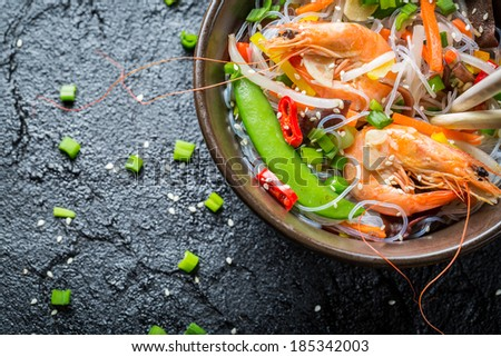 Vegetables served with prawns and noodles - stock photo