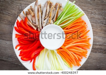 Vegetables sliced julienne, strips with sour cream dip, tatsy summer appetizer salad - stock photo
