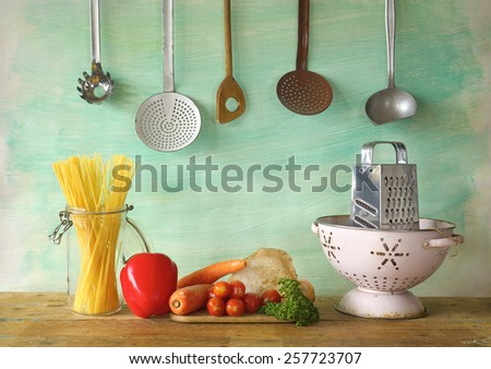 vegetables, spaghetti, kitchen utensils, free copy space - stock photo