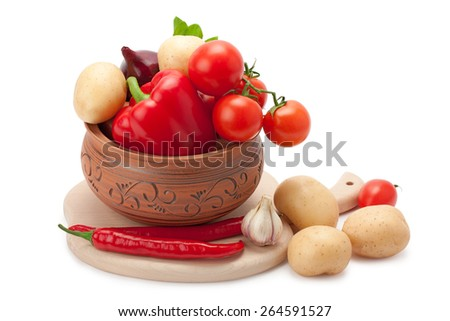 vegetables stacked in a clay pot isolated on white background - stock photo