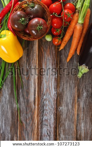 Vegetables still life in wooden background with copy space - stock photo