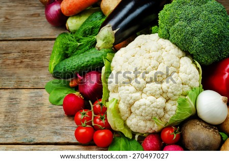 vegetables. tomatoes, potatoes, eggplant, zucchini, onion, carrot, radish, cucumber, tomato, peppers, spinach, cauliflower, broccoli, beets, parsley. the toning. selective focus - stock photo