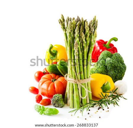 Vegetables with asparagus, paprika, broccoli, white sample text background - stock photo