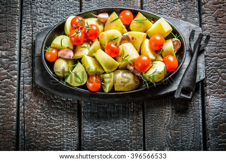 Vegetables with fresh tomato and garlic on barbecue dish - stock photo