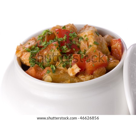 Vegetables with herbs in white pot. close up - stock photo