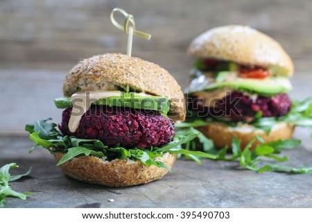 Vegetarian beetroot burgers with arugula and avocado - stock photo