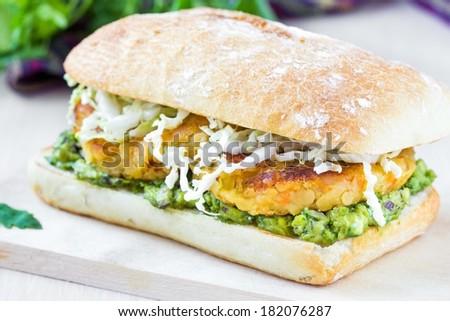 Vegetarian burger c lentils, guacamole, ciabatta, lettuce, delicious lenten dish - stock photo
