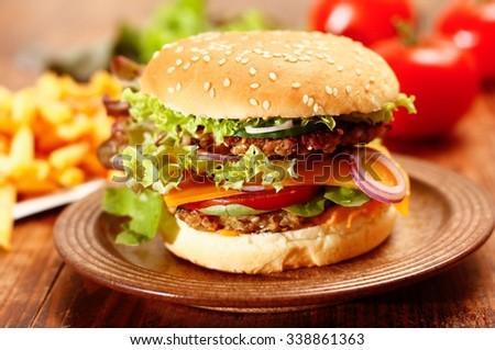 Vegetarian Cheeseburger and French fries - stock photo