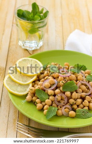Vegetarian chickpeas salad with mint and spices - stock photo